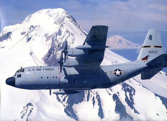 An Oregon Air National Guard C-130 Hercules transport aircraft flys over the Cascade Mountain Range in Oregon. (History photo from 142nd Fighter Wing History Office)
