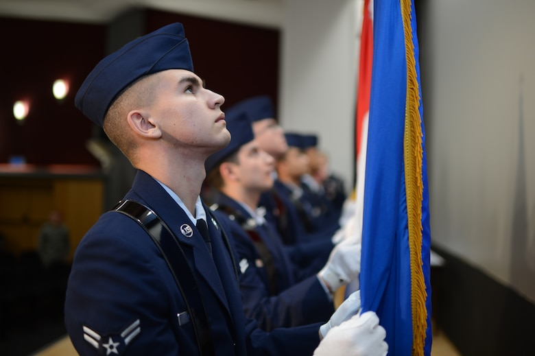 U.S. Air Force Airman 1st Class Michael McBride, 606th Air Control Squadron data maintenance technician from Orlando, Fla., posts the U.S. Air Force flag at an honor guard graduation and induction ceremony after a week-long training, on Spangdahlem Air Base Jan. 31, 2014. At the graduation, the honor guard trainees performed ceremonial honors which were learned and practiced over the week. (U.S. Air Force photo by Senior Airman Gustavo Castillo/Released)