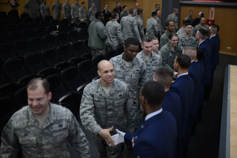 Airmen congratulate the newly inducted 52nd Fighter Wing Guard Members after a week-long training, at Spangdahlem Air Base Jan. 31, 2014. The Airmen who graduated from the training mastered the basics of ceremonial drill, advanced ceremonies and some funeral honor sequences. (U.S. Air Force photo by Senior Airman Gustavo Castillo/Released)