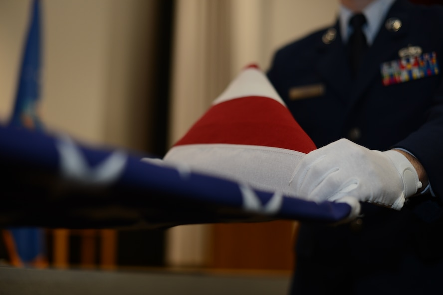 U.S. Air Force Staff Sgt. Richard Hiort, 52nd Component Maintenance Squadron avionics technician from Tewksburry, Mass., practices a ceremonial flag folding before his honor guard graduation, at Spangdahlem Air Base Jan. 31, 2014. The week-long trainings hope to bring in double the amount of honor guard members previously and will be held semi-annually. (U.S. Air Force photo by Senior Airman Gustavo Castillo/Released)