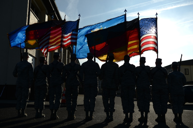 Two flag details, consisting of honor guard members in training, march during a training week, at Spangdahlem Air Base Jan. 29, 2014. The training week was the first iteration of the honor guard's new rigorous training program. (U.S. Air Force photo by Senior Airman Gustavo Castillo/Released)