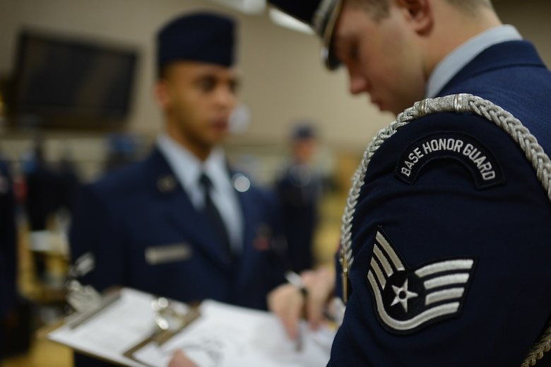 U.S. Air Force Staff Sgt. Josh McMillan, 52nd Fighter Wing Honor Guard NCO in charge of training, from San Antonio, conducts an inspection of aspiring honor guard members on Spangdahlem Air Base, Jan. 27, 2014. The aspiring honor guard members had to answer general Air Force knowledge and honor guard questions during the inspection. (U.S. Air Force photo by Senior Airman Gustavo Castillo/Released)