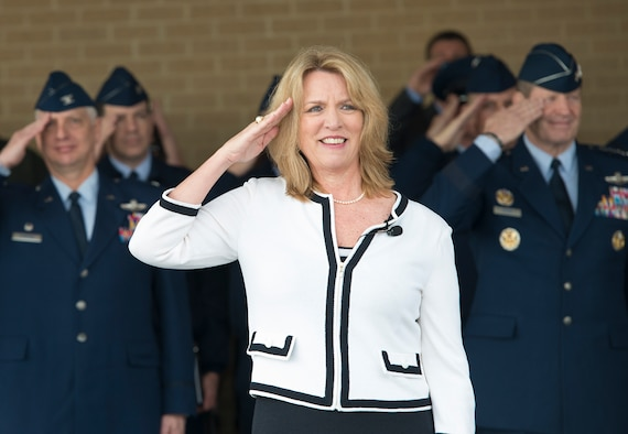 The Honorable Deborah L. James, Secretary of the Air Force, renders a salute during pass and review at the basic military training graduation January 31, 2014, at Joint Base San Antonio-Lackland. During her visit, James toured dormitory facilities and visited with officials at the 24th Air Force Headquarters before concluding her one-day visit with an Air Education and Training Command all call. (U.S. Air Force photo/Benjamin Faske)