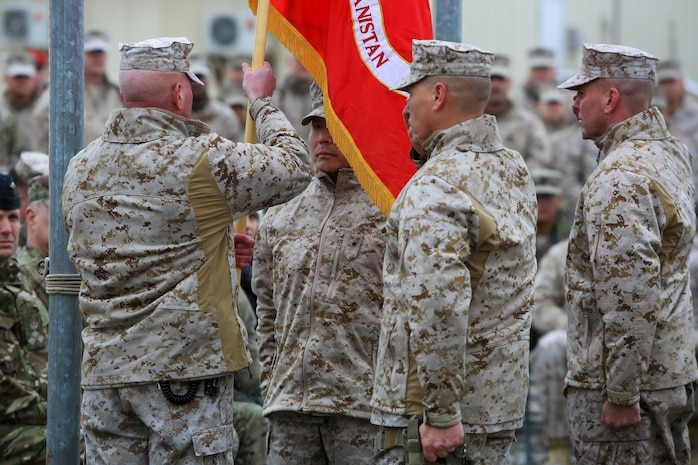 U.S. Marine Corps Maj. Gen. W. Lee Miller, Jr., left, Commanding General of the II Marine Expeditionary Force (MEF) Forward passes the Regional Command Southwest colors to B. Gen. Daniel D. Yoo, Commanding General of Marine Expeditionary Brigade Afghanistan (MEB-A), as part of a Transfer of Authority ceremony on Camp Leatherneck, Helmand province, Afghanistan, Feb. 5, 2014. MEB-A officially relieved II MEF (FWD) and took over their responsibilities for Regional Command (Southwest). (Official Marine Corps Photo by Lance Cpl. Darien J. Bjorndal/Released)