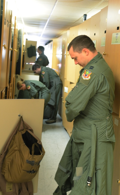 Capt. Daniel Snyder, 391st Fighter Squadron trainer, from Mountain Home Air Force Base, Idaho, puts on his Anti-G suit before a sortie Feb. 3, 2014, at Nellis Air Force Base, Nev. Twelve aircraft along with more than 150 service members are currently on temporary duty assignment to Nellis AFB participating in the multinational combat exercise Red Flag 14-1. Red Flag gives aircrews and air support operations service members from various airframes, military services and allied countries an opportunity to integrate and practice combat operations. (U.S. Air Force photo by Senior Airman Benjamin Sutton/Released)