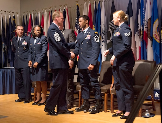 Chief Master Sgt. of the Air Force James A. Cody shakes hands with Airmen selected for Portraits in Courage Feb. 5, 2014, during a recognition ceremony in Arlington, Va.  Portraits in Courage highlights individual Airmen for their honor, valor, devotion and selfless sacrifice in the face of extreme danger to themselves and others.  (U.S. Air Force photo/Jim Varhegyi)