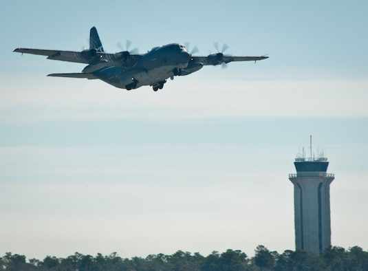 The newly created AC-130J Ghostrider takes to the air during its first official sortie Jan. 31, 2014 at Eglin Air Force Base, Fla. The Air Force Special Operations Command MC-130J arrived at Eglin AFB in January of 2013 to begin the modification process for the AC-130J, whose primary mission is close air support, air interdiction and armed reconnaissance. (U.S. Air Force photo/Sara Vidoni)