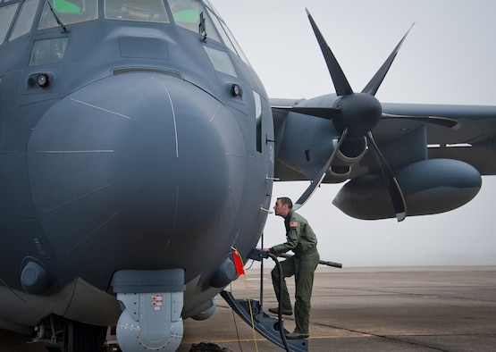 Capt. Steve Visalli boards the newly created AC-130J Ghostrider in anticipation of its first official sortie Jan. 31, 2014 at Eglin Air Force Base, Fla. The AC-130J's primary mission is close air support, air interdiction and armed reconnaissance. Visalli is a flight test engineer with the 413th Flight Test Squadron. (U.S. Air Force photo/Chrissy Cuttita)
