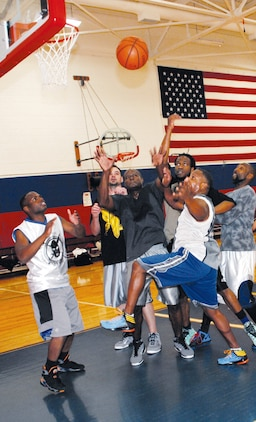 A host of players battle for control of the ball during a recent lunchtime pickup basketball game at Thomason Gymnasium at Marine Corps Logistics Base Albany, recently.