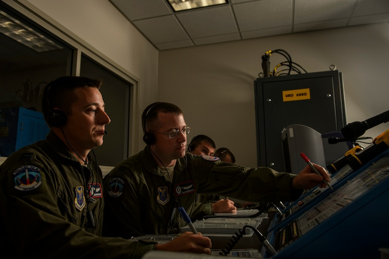 Capt. Daniel Moore, left, and Capt. Kyle Heiderich, right, check a launch control center panel during missile launch procedures training Feb. 3, 2014, at Vandenberg Air Force Base, Calif. The 576th Flight Test Squadron is America's only ICBM training and testing squadron that conducts an average of three to four test launches a year. (U.S. Air Force photo/Staff Sgt. Jonathan Snyder)
