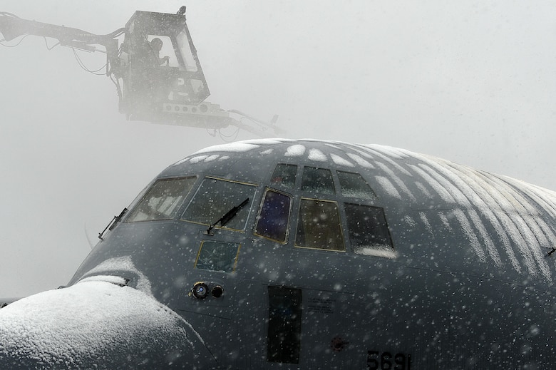 An Airman defrosts a C-130J Super Hercules Feb. 6, 2014, at Bagram Airfield, Afghanistan. A de-icer truck uses a half-and-half mixture of a red fluid and water, sprayed at high pressure, to remove ice from the surface of aircraft during the winter seasons. (U.S. Air Force photo/Senior Airman Kayla Newman)