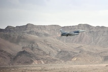 An F-16 Fighting Falcon takes off for a sortie training mission during Red Flag 14-1, Jan. 30, 2014, at Nellis Air Force Base, Nev. Combat units come together from the U.S. and its allied countries to engage in realistic combat training scenarios within Nellis AFB's 2.9 million acre Test and Training Range Complex. The F-16 is assigned to the 120th Fighter Squadron at Buckley Air Force Base, Colorado Air National Guard. (U.S. Air National Guard photo/Tech. Sgt. Wolfram M. Stumpf)