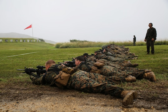 Reconnaissance Marines from 3rd Reconnaissance Battalion, 3rd Marine Division, lie in the prone position while conducting marksmanship training at Kaneohe Bay Range Training Facility, Feb. 4, 2014. (U.S. Marine Corps photo by Lance Cpl. Suzanna Knotts)