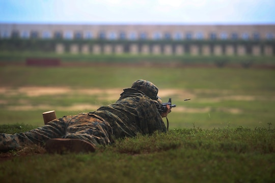 Lance Cpl. Quincy Gilliland, a bulk fuels specialist with Marine Corps Base Hawaii Fuels and a 22-year-old native of Liberty, N.C., shoots his weapon in the prone position during the Pacific Division Shooting Competition on Puuloa Training Facility, Feb. 5, 2014. (U.S. Marine Corps photo by Cpl. Nathan Knapke)