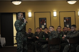 Second Lt. John Rubia tells the Marines of The Basic School's Echo Company about the Philippians and the Filipino Marine Corps during the company's International Officers Dinner on Jan. 14 at Lopez Hall. The dinner is a new tradition at TBS.