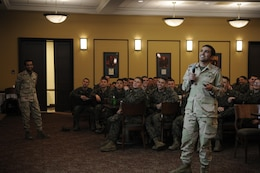 First Lt. Mohammed Alsubaie tells the Marines of The Basic School's Echo Company about his home country of Saudi Arabia while his countryman, Capt. Mohammed Mushawwah, looks on during the company's International Officers Dinner at Lopez Hall on Jan. 14. The dinner is a new tradition at TBS.
