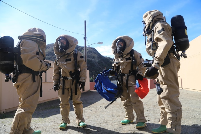 Marines with the 11th Marine Expeditionary Units Chemical, Biological, Radiological, and Nuclear defense section conduct sensitive site exploitation training here Feb. 7. During the training, a reconnaissance team patrolled a seemingly deserted simulated town to locate any potential contaminations and marked them with chemical lights. The sample team took samples from each marked site for further examination.