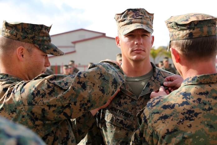 Sgt. Loren Moneypenny, a scout sniper with Weapons Company, 2nd Battalion, 1st Marines, is pinned to his current rank aboard Camp Pendleton, Calif. Feb.7. Moneypenny earned his promotion meritoriously after competing with Marines across the I Marine Expeditionary Force.