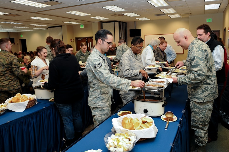 Members of Team Buckley dish up food at the National Prayer Luncheon Feb. 5, 2014, at the chapel on Buckley Air Force Base, Colo. More than 350 Team Buckley members attended the luncheon, an annual event that encourages believers of any religion to seek their God through prayer. (U.S. Air Force photo by Senior Airman Phillip Houk/Released)