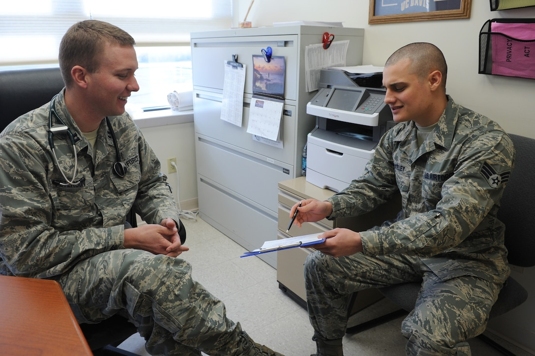 Senior Airman Casey Blakeley, 341st Medical Operations Squadron Family Health Clinic medical technician (right) gives Capt. Trevor Peterson, 341st MDOS Family Health Clinic staff physician, a patient history before an appointment at the Malmstrom Air Force Base Clinic on Jan. 28. The family health clinic has three physicians, two physician assistants, two nurses and 12 active-duty medical technicians. (U.S. Air Force photo/Senior Airman Katrina Heikkinen)