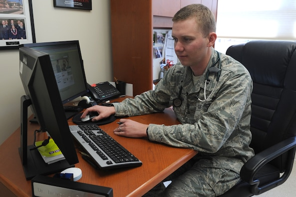 Capt. Trevor Peterson, 341st Medical Operations Squadron Family Health Clinic staff physician, reviews messages in the Air Force Medical Service MiCare system at the Malmstrom Air Force Base Clinic on Jan. 28. Peterson replies to approximately 10 messages from patients on a daily basis. (U.S. Air Force photo/Senior Airman Katrina Heikkinen)