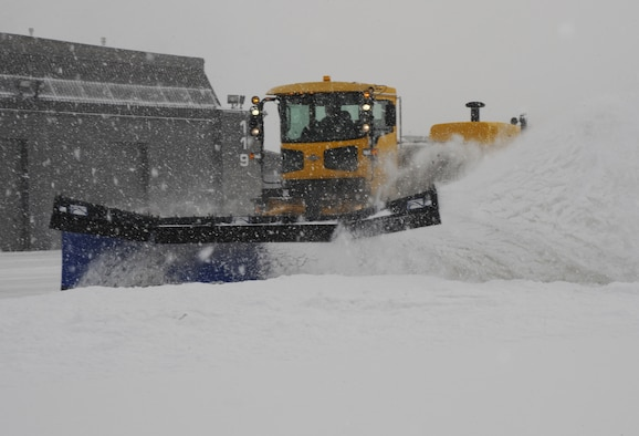 PETERSON AIR FORCE BASE, Colo. -- Staff Sgt. Matthew Cincotta, 21st Civil Engineer Squadron heavy equipment vehicle operator, uses a snow plow to remove snow from the flightline here Feb. 4. The 21st CES has four plows specifically for the flightline. Heavy equipment vehicle operators work in teams of three or four to clear the flightline as quickly as possible. (U.S. Air Force photo/Staff Sgt. Jacob Morgan)