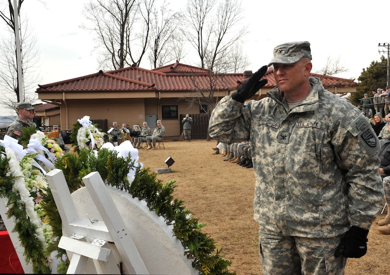 U.S. Col. Joseph Gleichenhaus, 3rd Battlefield Coordination Detachment-Korea commander, salutes a wreath honoring those who fought and those who gave their lives in the Battle of Bayonet Hill during the Hill 180 remembrance ceremony at Osan Air Base, Republic of Korea, Feb. 7, 2014. Base personnel thronged the area near the battle's monument to witness the annual ceremony and subsequent laying of the wreaths. (U.S. Air Force photo/Airman 1st Class Ashley J. Thum)