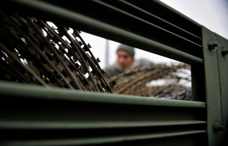 Concertina wire sits in the bed of a truck, waiting to be used as a barrier during Operational Readiness Exercise Beverly Midnight 14-02 at Osan Air Base, Republic of Korea, Feb. 9, 2014. During exercises and war-time contingency operations, c-wire is placed strategically around the base. (U.S. Air Force photo/Senior Airman Siuta B. Ika)