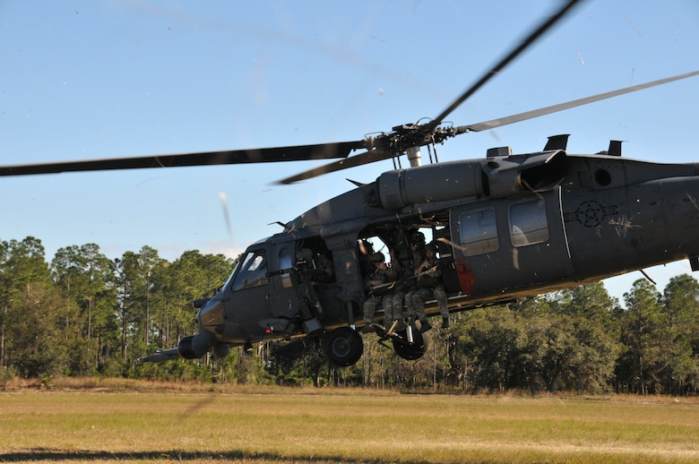 Members from the 147th Reconnaissance Wing Air Support Operations Squadron lift off in a HH-60 Pave Hawk at Avon Park Air Force Range, Florida December 16, 2013. Performing exercises at the Florida range allows the airmen to hone the necessary skill sets to perform their jobs and missions in an environment that allows for the use of live fighter aircraft and live munitions to replicate real-life warfighting scenarios. National Guard photo by 2nd Lt. Alicia Lacy.