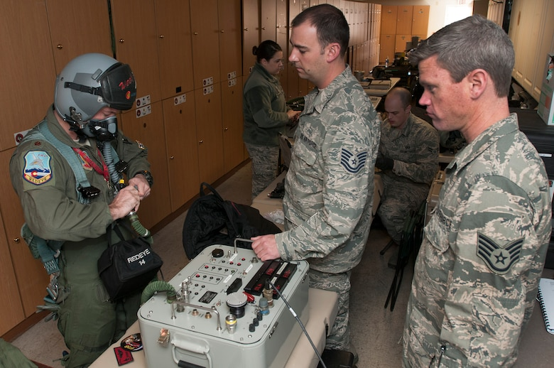 U.S. Air Force Maj. Jeremiah Tucker (left), 120th Fighter Squadron, Colorado Air National Guard tests his flight equipment with Tech. Sgt. Jared McCartney (center) and Staff Sgt. Joshua Frizzell (right), 140th Operations Support Squadron, during Red Flag 14-1, at Nellis Air Force Base, Nev., Feb. 03, 2014. Combat units come together from the United States and its allied countries to engage in realistic combat training scenarios within Nellis' 2.9 million acre Test and Training Range Complex. (U.S. Air National Guard photo/Tech. Sgt. Wolfram M. Stumpf)