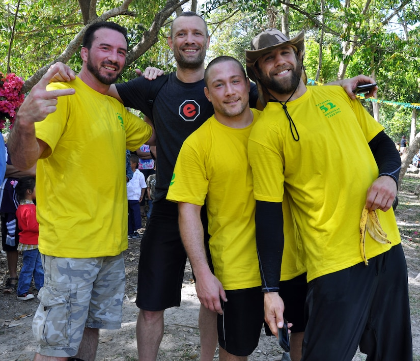 """Ultimate Fighting Championship (UFC) professional fighters Kyle Kingsbury, Mike Pierce, Nate """"Rock"""" Quarry and Steven Josephy pose for a photo during the 52nd Joint Task Force-Bravo """"Chapel Hike"""" in Honduras, Feb. 8, 2014. More than 120 members of Joint Task Force-Bravo spent the day delivering more than 2,400 pounds of food and medical supplies to families in need in the mountain village of La Laguna, Honduras. To deliver the supplies, Task Force members carried the items on a more than seven-mile round trip hike, with an elevation gain of 1,700 feet. All of the food and supplies were purchased with funds donated by Task Force members.  The four professional fighters were visiting Soto Cano to provide a mixed martial arts demonstration for Task Force members and joined Joint Task Force-Bravo on the Chapel Hike.  (U.S. Air Force photo by Capt. Zach Anderson)"""
