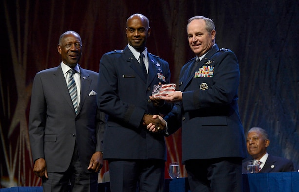 Air Force Chief of Staff Gen. Mark A. Welsh III and former Air Force Vice Chief of Staff Gen. Lester L. Lyles congratulate Brig. Gen. Cedric D. George on his receipt of the Black Engineer of the Year Award at the Ninth Annual Stars and Stripes dinner, Feb. 7, 2014, in Washington, D.C. George is the commander of the Warner Robins Air Logistics Complex, Robins Air Force Base, Ga. The dinner is held every year to honor engineers, both active and retired African American general officers and members of the senior executive service.  (U.S. Air Force photo/Scott M. Ash)