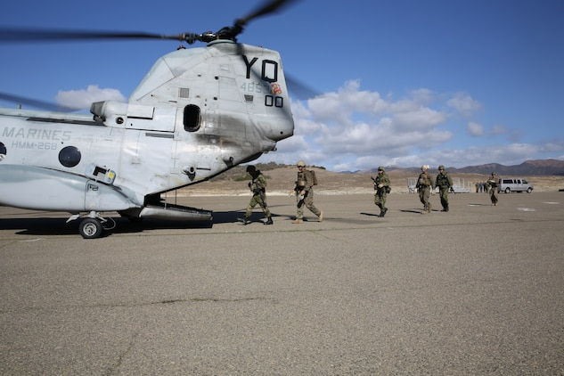 U.S. Marines with 1st Reconnaissance Battalion, 1st Marine Division, and soldiers with the Japan Ground Self-Defense Force board a CH-46E Sea Knight to perform fast-rope insertion training during Exercise Iron Fist 2014 aboard Camp Pendleton, Calif., Feb. 5, 2014. Iron Fist is an amphibious exercise that brings together Marines and sailors from the 15th Marine Expeditionary Unit, other I Marine Expeditionary Force units, and soldiers from the JGSDF, to promote military interoperability and hone individual and small-unit skills through challenging, complex and realistic training.