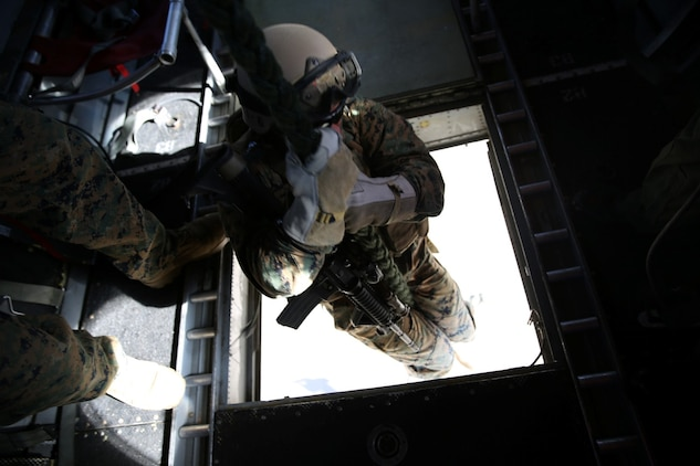 A U.S. Marine with 1st Reconnaissance Battalion, 1st Marine Division, descends from a CH-46E Sea Knight while performing fast-rope insertion training during Exercise Iron Fist 2014 aboard Camp Pendleton, Calif., Feb. 5, 2014. Iron Fist is an amphibious exercise that brings together Marines and sailors from the 15th Marine Expeditionary Unit, other I Marine Expeditionary Force units, and soldiers from the Japan Ground Self-Defense Force, to promote military interoperability and hone individual and small-unit skills through challenging, complex and realistic training.