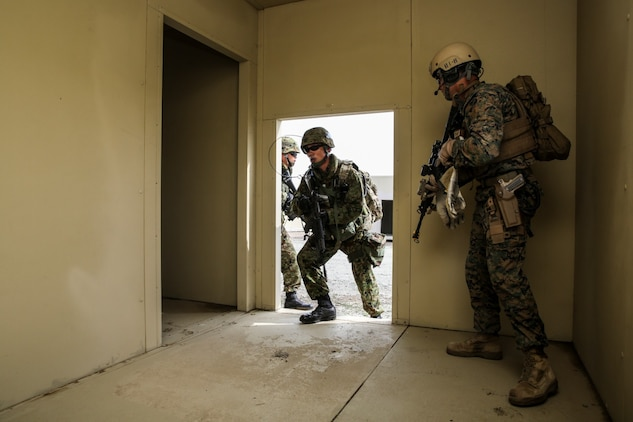 U.S. Marines with 1st Reconnaissance Battalion, 1st Marine Division, and soldiers from the Japan Ground Self-Defense Force clear a building while conducting raid training during Exercise Iron Fist 2014 aboard Camp Pendleton, Calif., Feb. 7, 2014. Iron Fist is an amphibious exercise that brings together Marines and sailors from the 15th Marine Expeditionary Unit, other I Marine Expeditionary Force units, and soldiers from the JGSDF, to promote military interoperability and hone individual and small-unit skills through challenging, complex and realistic training.