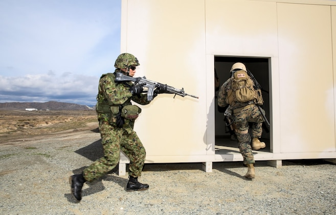 A U.S. Marine with 1st Reconnaissance Battalion, 1st Marine Division, and a soldier with the Japan Ground Self-Defense Force enter a building while conducting raid training during Exercise Iron Fist 2014 aboard Camp Pendleton, Calif., Feb. 7, 2014. Iron Fist is an amphibious exercise that brings together Marines and sailors from the 15th Marine Expeditionary Unit, other I Marine Expeditionary Force units, and soldiers from the JGSDF, to promote military interoperability and hone individual and small-unit skills through challenging, complex and realistic training.