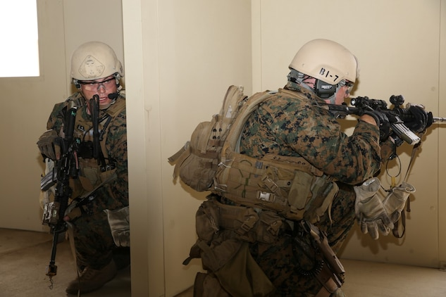 U.S. Marines with 1st Reconnaissance Battalion, 1st Marine Division, prepare to exit a building and move toward their next objective while conducting raid training during Exercise Iron Fist 2014 aboard Camp Pendleton Calif., Feb. 7, 2014. Iron Fist is an amphibious exercise that brings together Marines and sailors from the 15th Marine Expeditionary Unit, other I Marine Expeditionary Force units and soldiers from the Japan Ground Self-Defense Force, to promote military interoperability and hone individual and small-unit skills through challenging, complex and realistic training.