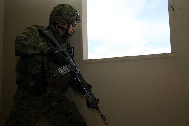 A U.S. Marine with 1st Reconnaissance Battalion, 1st Marine Division, and soldiers from the Japan Ground Self-Defense Force exit a building and move toward their next objective while conducting raid training during Exercise Iron Fist 2014 aboard Camp Pendleton Calif., Feb. 7, 2014. Iron Fist is an amphibious exercise that brings together Marines and sailors from the 15th Marine Expeditionary Unit, other I Marine Expeditionary Force units and soldiers from the JGSDF, to promote military interoperability and hone individual and small-unit skills through challenging, complex and realistic training.
