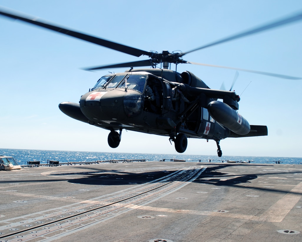A UH-60 Blackhawk helicopter assigned to Joint Task Force Bravo's 1-228th Aviation Regiment comes in for a landing on the deck of the USS Rentz during deck landing qualification training off the coast of Honduras, Feb. 8, 2014. The training, which was conducted approximately 70 miles off the coast of Honduras, was done to qualify 1-228th pilots and crew chiefs on shipboard operations. (Courtesy photo)