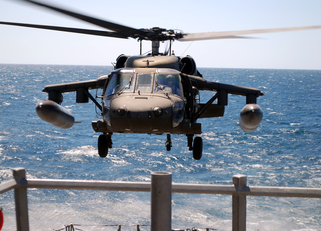 A UH-60 Blackhawk helicopter assigned to Joint Task Force Bravo's 1-228th Aviation Regiment makes an approach for a landing on the deck of the USS Rentz during deck landing qualification training off the coast of Honduras, Feb. 8, 2014. The training, which was conducted approximately 70 miles off the coast of Honduras, was done to qualify 1-228th pilots and crew chiefs on shipboard operations. (Courtesy photo)