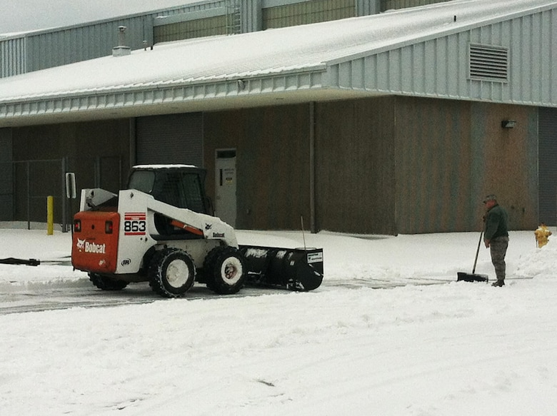 Airmen from the 142nd Fighter Wing Civil Engineer Squadron work to remove snow and ice from the Portland Air National Guard Base, Ore., Feb. 8, 2014.  The February Unit Training Assembly was cancelled, but a small group from the CES worked over the weekend to keep the base running and the alert mission operational during the winter storm that hit the Pacific Northwest region. (photo courtesy of Lt. Col. Jason Lay, 142nd Fighter Wing Civil Engineers)