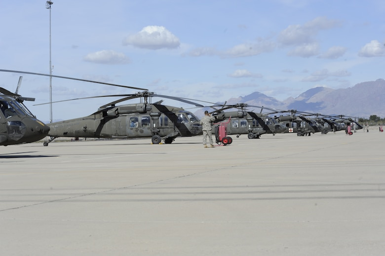Ten UH-60 Black Hawks, assigned to the 3-227th Assault Helicopter Battalion, 1st Air Calvary Brigade, 1st Cavalry Division out of Fort Hood, Texas, park on the flightline at Davis-Monthan Air Force Base, Ariz., Feb. 7, 2014. The unit was headed to California for training when they stopped at D-M for refueling. (U.S. Air Force photo by Airman 1st Class Betty R. Chevalier/released)