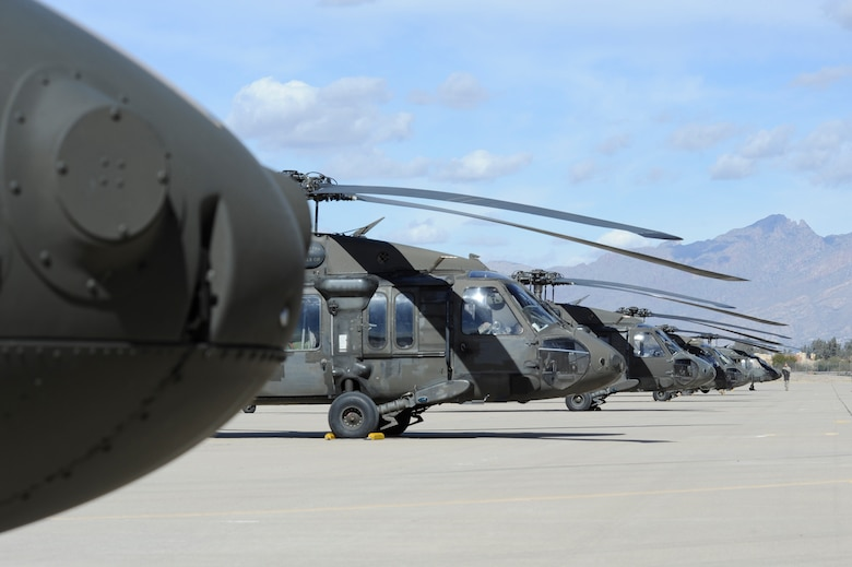 Ten UH-60 Black Hawks, assigned to the 3-227th Assault Helicopter Battalion, 1st Air Calvary Brigade, 1st Cavalry Division out of Fort Hood, Texas, park on the flightline at Davis-Monthan Air Force Base, Ariz., Feb. 7, 2014. The unit was traveling to California for training and will transit back to Texas in about a month. (U.S. Air Force photo by Airman 1st Class Betty R. Chevalier/released)