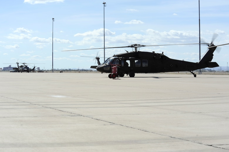 U.S. Army UH-60 Black Hawks taxi onto a ramp after arriving at Davis-Monthan Air Force Base, Ariz., Feb. 7, 2014. Ten Black Hawks from Fort Hood, Tex. stopped at D-M for refueling on their way to California for a month-long training exercise. (U.S. Air Force photo by Airman 1st Class Betty R. Chevalier/released)