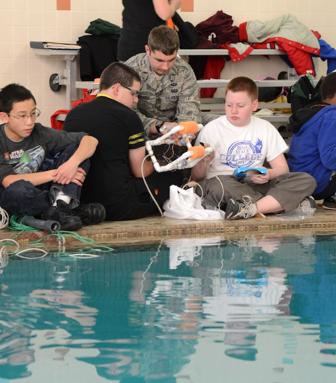 2nd Lt. Jeff Desroches, with the 423rd Supply Chain Management Squadron, helps Kyle Teel and Hunter Wood, both eighth graders, with their SeaPerch ROV.SeaPerch is an underwater robotics program that integrates Science, Technology, Engineering and Mathematics curriculum and pairs students with mentors to learn more about the STEM concepts. Students from Carl Albert Middle School and mentors from Tinker worked together with Starbase Oklahoma to make this character and career-building program successful.