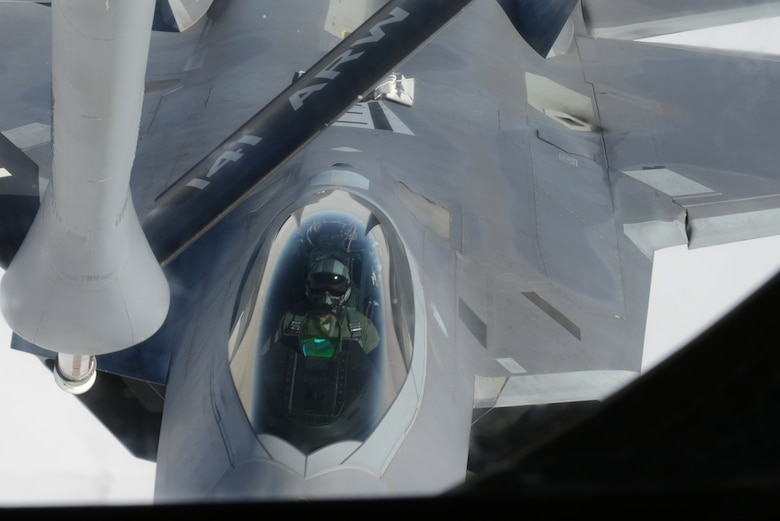 An F-22 Raptor from the 1st Fighter Wing, Joint Base Langley-Eustis, Va., closes in on the refueling boom Feb. 6, 2014, over the Nevada Test and Training Range. More than 20 units from across the globe are at Nellis Air Force Base, Nev., to participate in Red Flag 14-1. The Raptors were refueled by a KC-135 Stratotanker from the 93rd Air Refueling Squadron from Fairchild AFB, Wash. Since its establishment in 1975, Red Flag has played host to military units from more than 30 different countries. (U.S. Air Force photo by Senior Airman Benjamin Sutton/Released)