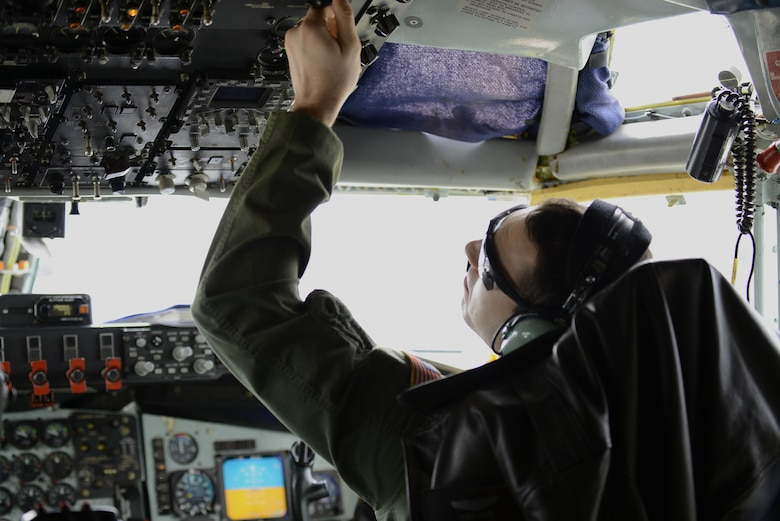 1st Lt. Chris Carr, 93rd Air Refueling Squadron co-pilot from Fairchild Air Force Base, Wash., prepares a KC-135 Stratotanker for a flight during Feb. 6, 2014, at Nellis Air Force Base, Nev. Carr is on temporary duty assignment to Nellis AFB, participating in Red Flag 14-1. Airmen fly daily missions in order to maximize the training opportunities provided by Red Flag for both air and ground crews. (U.S. Air Force photo by Senior Airman Benjamin Sutton/Released)