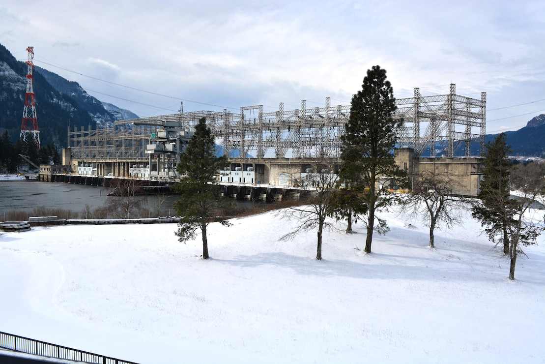 Shows winter snowfall at Bonneville Lock and Dam's First Powerhouse and spillway on Feb. 7, 2014.