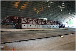 The Heavy Vehicle Simulator (HVS) tests asphalt pavement sections in the ERDC Pavement Testing Facility.