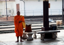 A Monk waits for the next train at the train station  in Phitsanulok, Kingdom of Thailand, on Feb. 06, 2014. U.S.  Marines with Civil Affairs Attachment, G3 Operations, III Marine Expeditionary Force visit the Phitsanulok train station and bus terminal to determine their capabilities during exercise Cobra Gold 2014 (CG 14). CG 14, in its 33rd iteration, demonstrates the U.S. and the Kingdom of Thailand's commitment to our long-standing alliance and regional partnership, prosperity and security in the Asia-Pacific region. (U.S. Marine Corps photo by Lance Cpl. Leah Agler/ Released)
